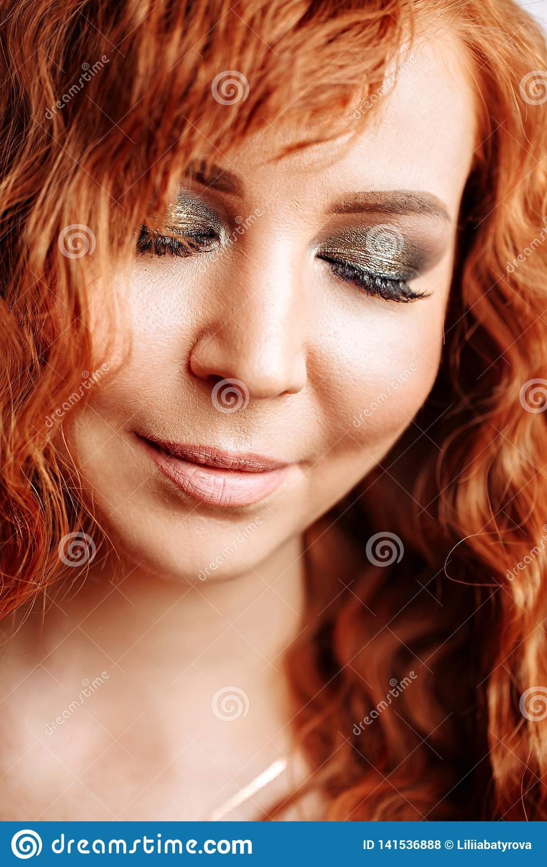 Close up portrait of young beautiful redhead girl