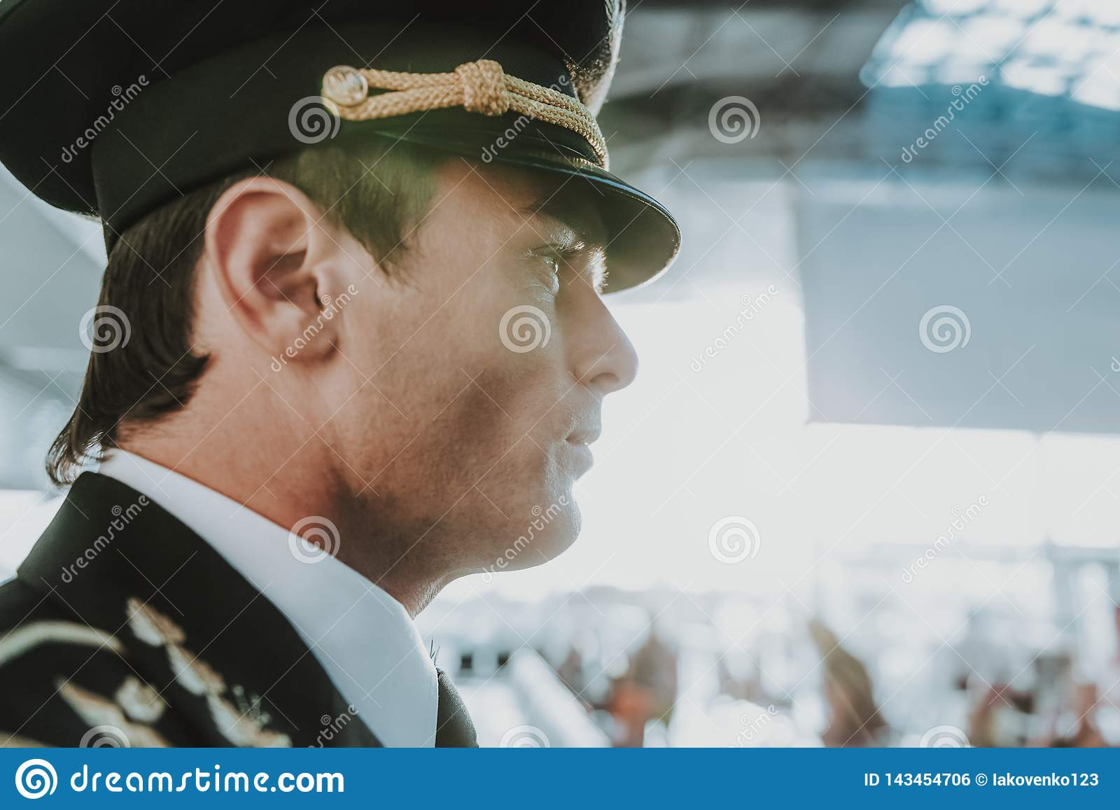Handsome young pilot standing in the airport