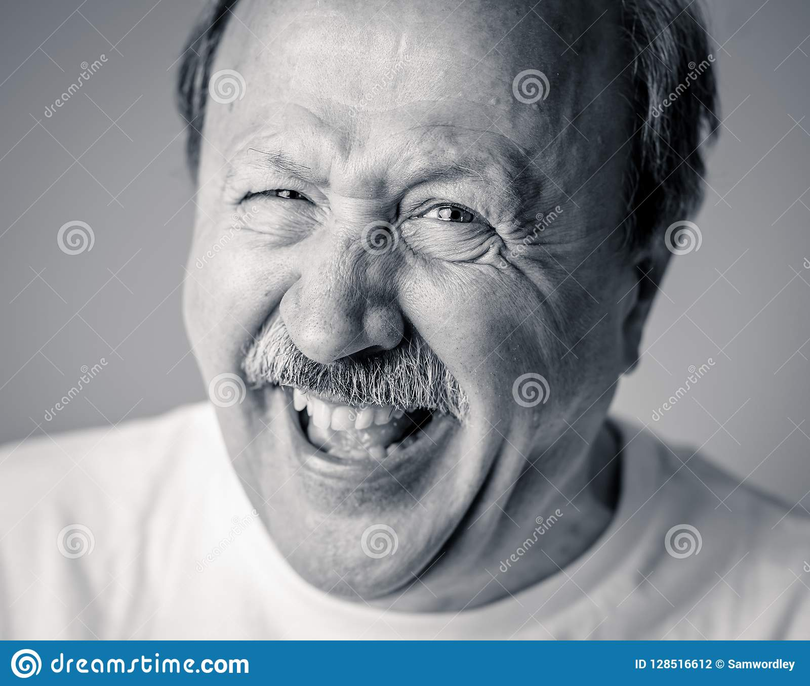Close up portrait of smiling senior man with happy face looking at the camera