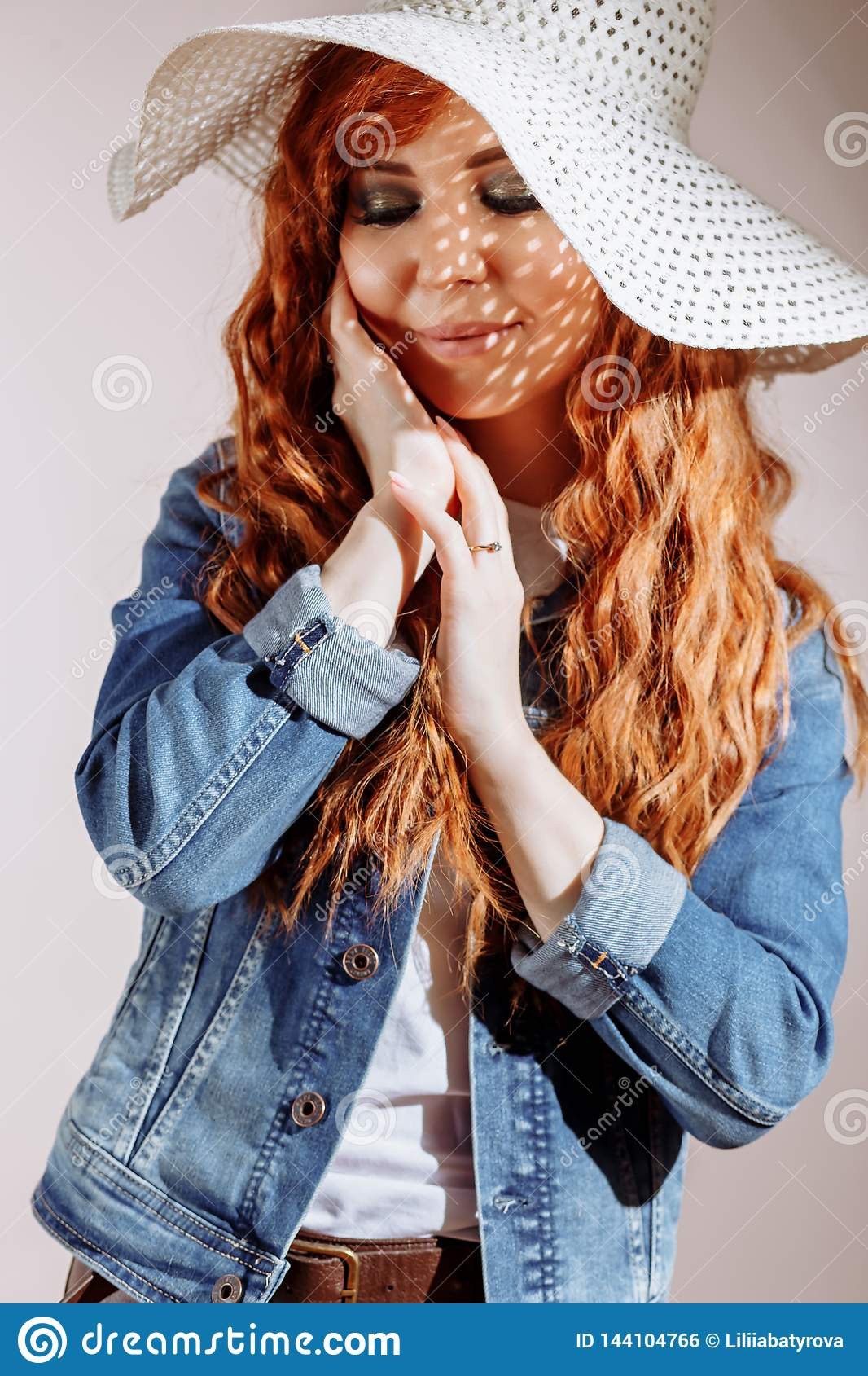 Redhead woman wearing hat on white background