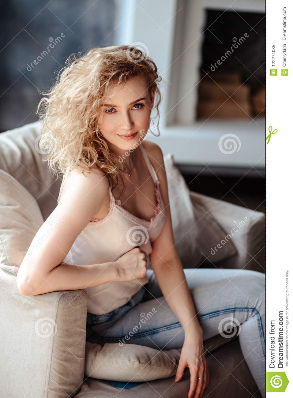 Close Up Portrait Of Sweet Blonde Woman In A Casual Jeans Clothes