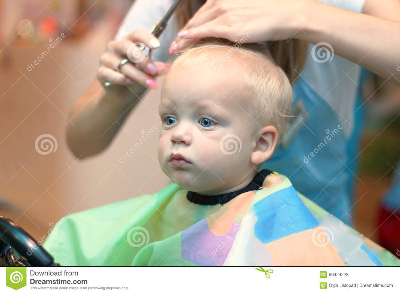 Close Up Portrait Of Toddler Child Getting His First Haircut Stock