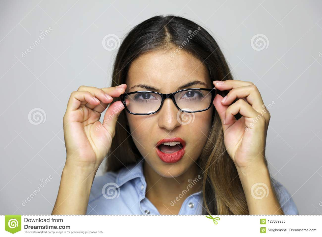 Close up portrait of a very skeptical woman or She does not see well need new glasses