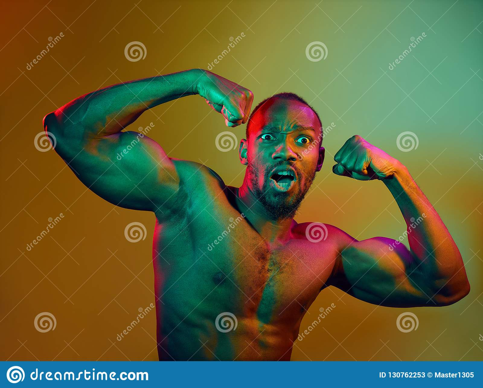 Close Up Portrait Of A Young Naked African Man Looking At Camera Indoors Stock Image - Image of