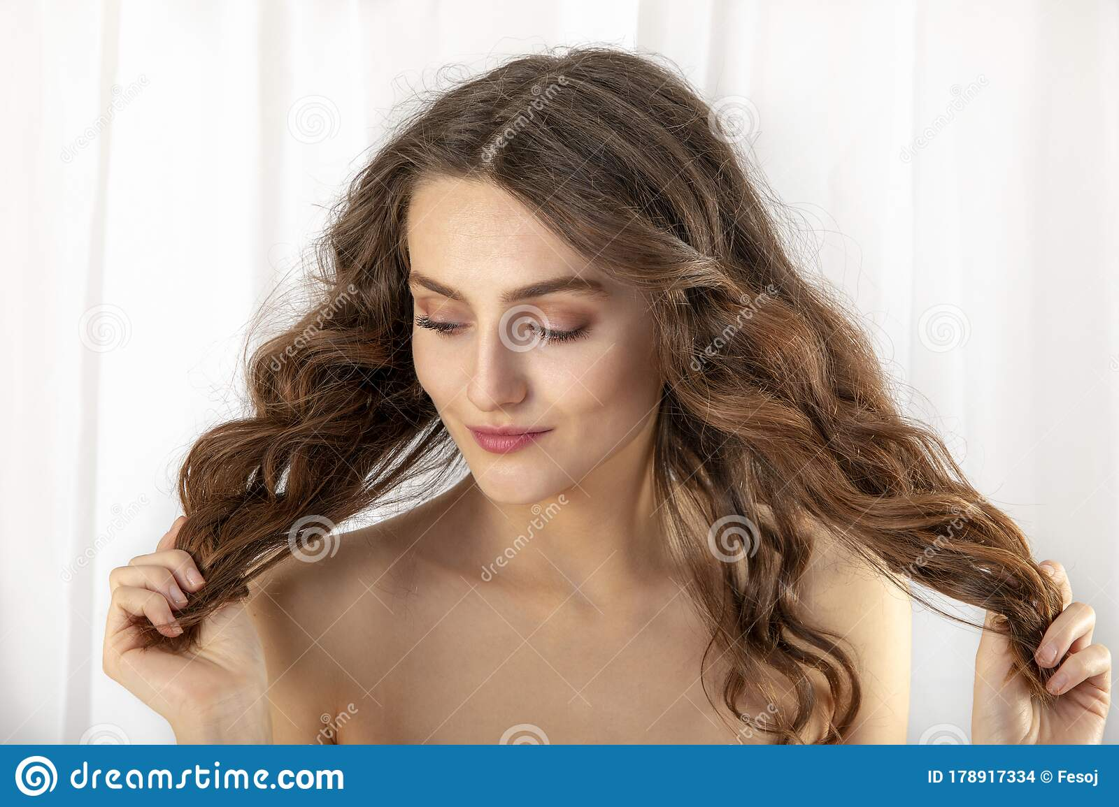 Young Woman Looking Over Shoulder Portrait High-Res Stock