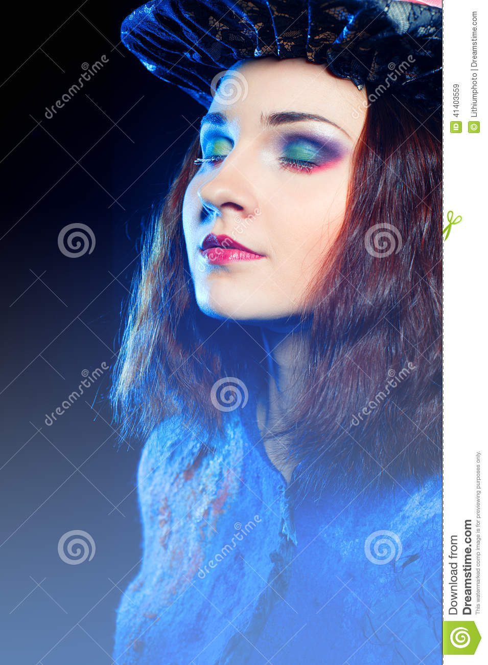 Close-up portrait of young woman in the similitude of the Hatter