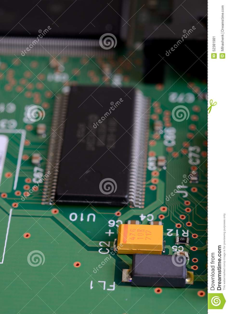 Surface Mount Components On A Green Circuit Board