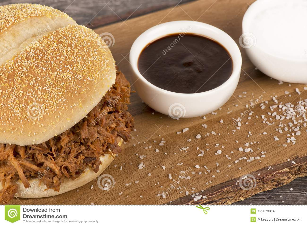 Close Up On A Pulled Pork Sandwich And Barbecue Sauce Stock