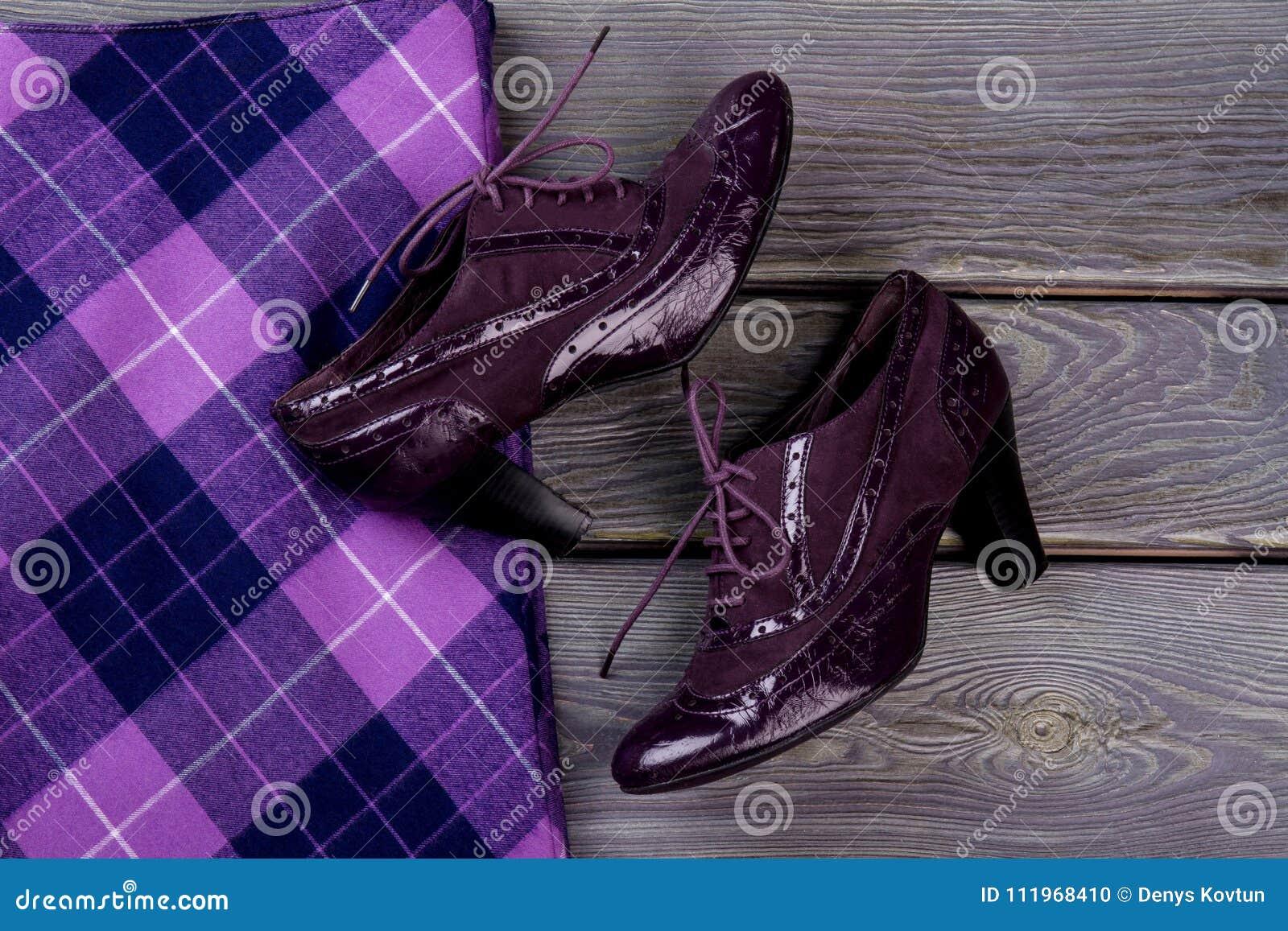 Close up purple shiny heel shoes.