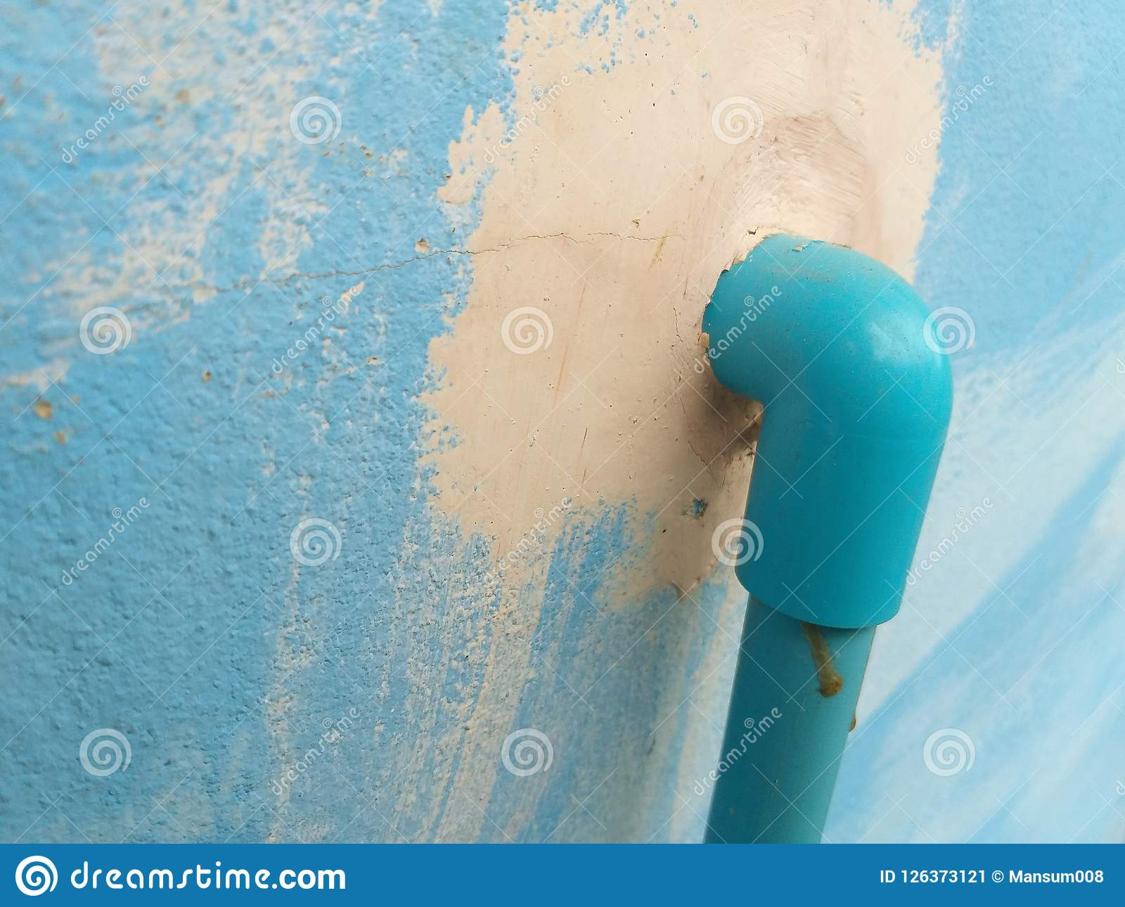 Pvc Pipe On Blue Cement Wall Texture Stock Image - Image of