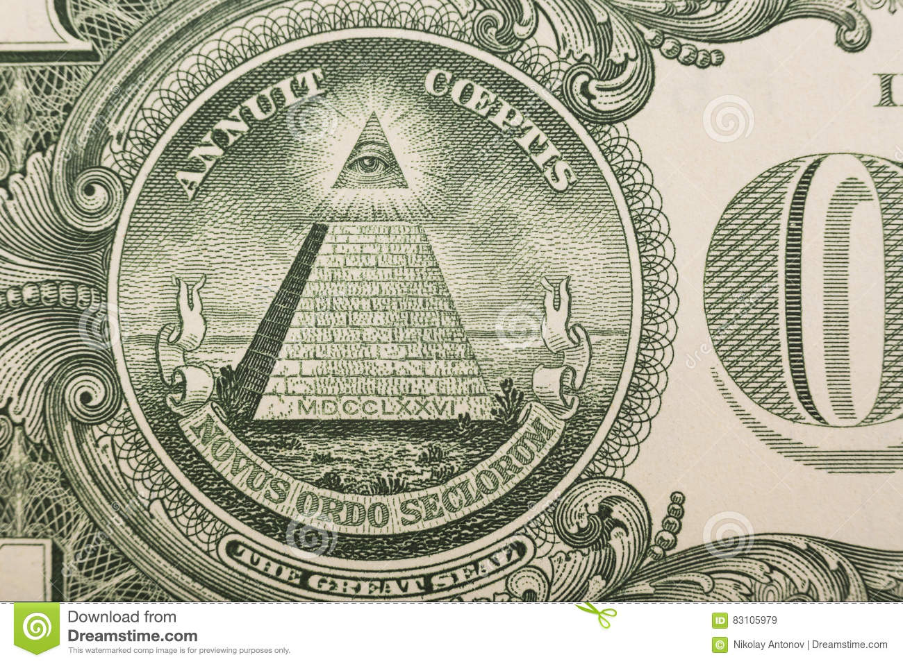 Close up of the pyramid and eye on the back of a one dollar bill