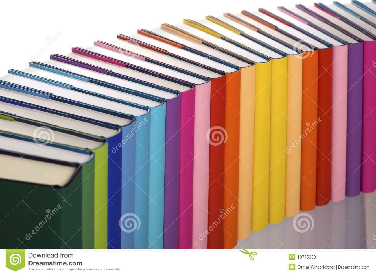 Close-up of curve aligned in rainbow colors paper wrapped books with ...