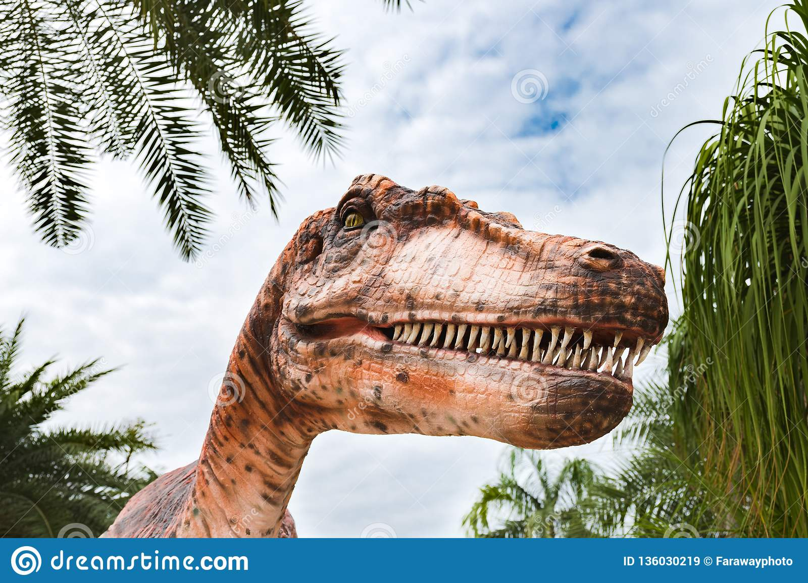 Close up on a realistic statue of Tyrannosaurus in dinosaur park