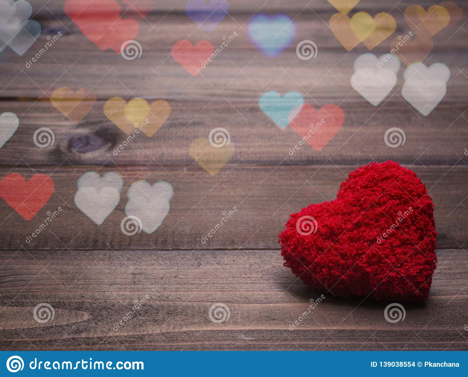 Red cushion heart shape on wood background
