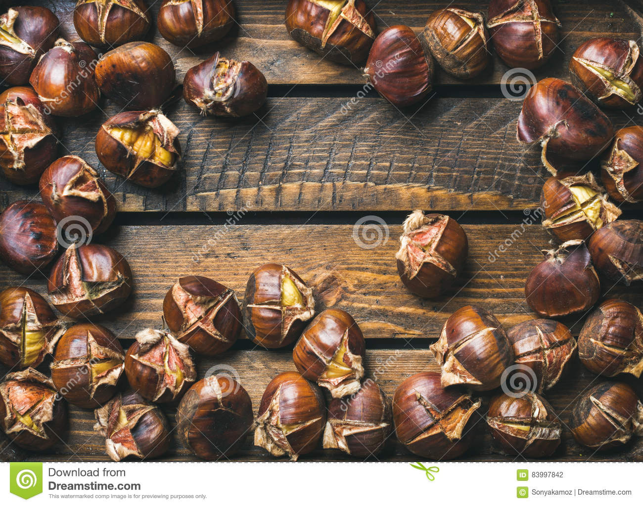Close-up of roasted chestnuts over rustic wooden background