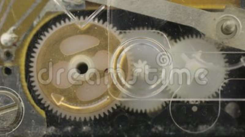 Close-up  Rotation of the plastic gears of the old clock