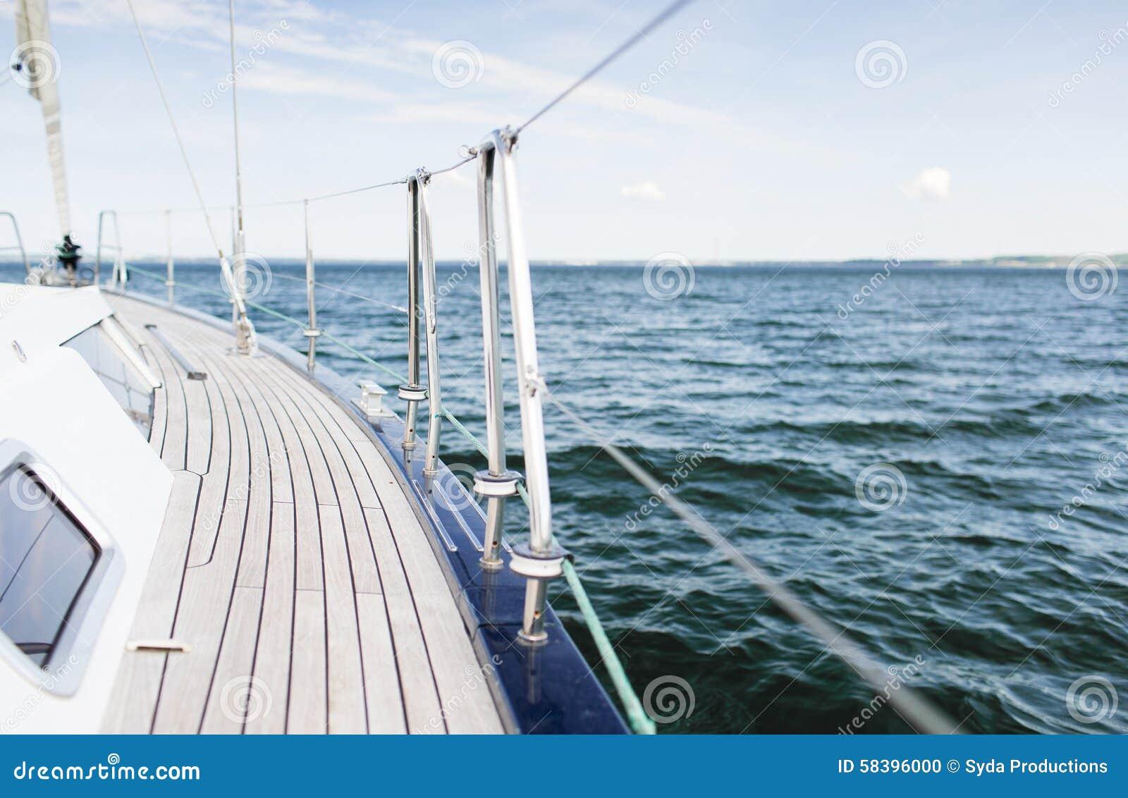 Close Up Of Sailboat Or Sailing Yacht Deck And Sea Stock ...