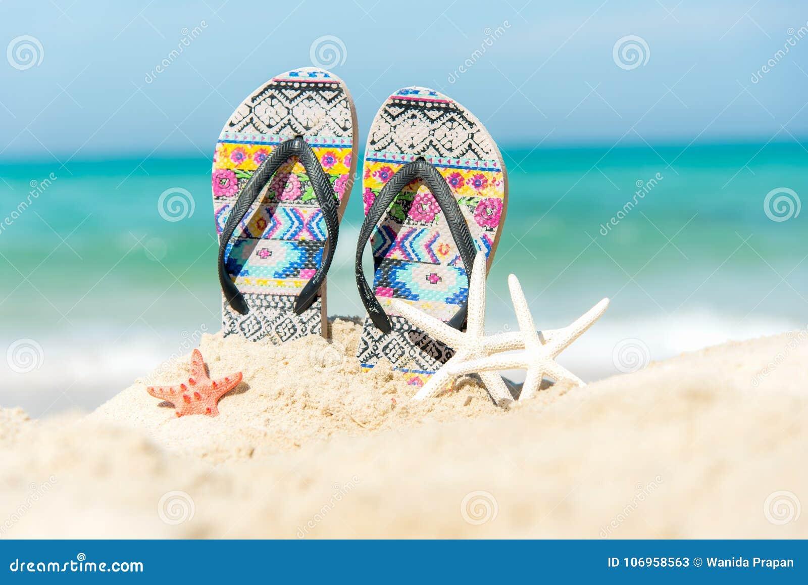 8046204191b7 Close Up Sandals On The Sand Beach With Starfish Sandy Beach. Stock ...