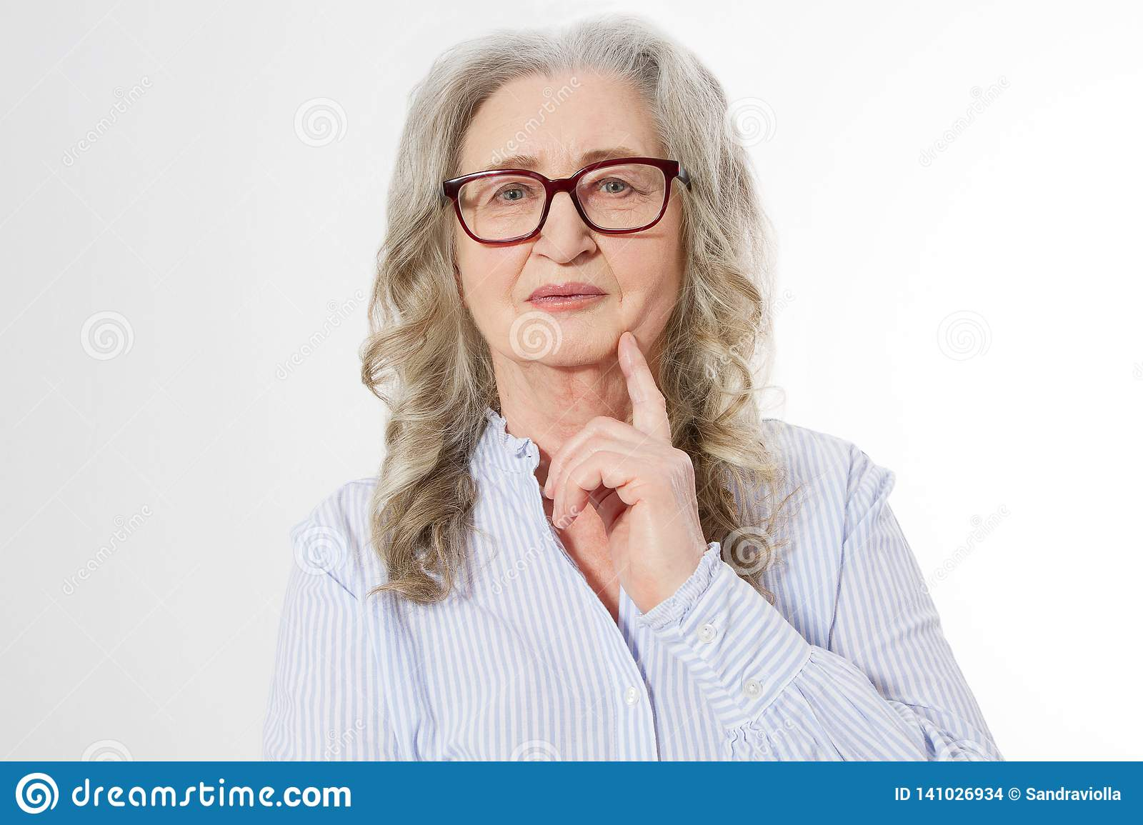 Close up Senior business woman with stylish glasses and wrinkle face isolated on white background. Mature healthy lady. Copy space