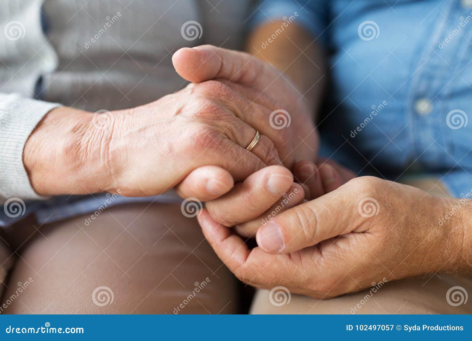 Close Up Senior Couple Holding Hands Stock Image Image of