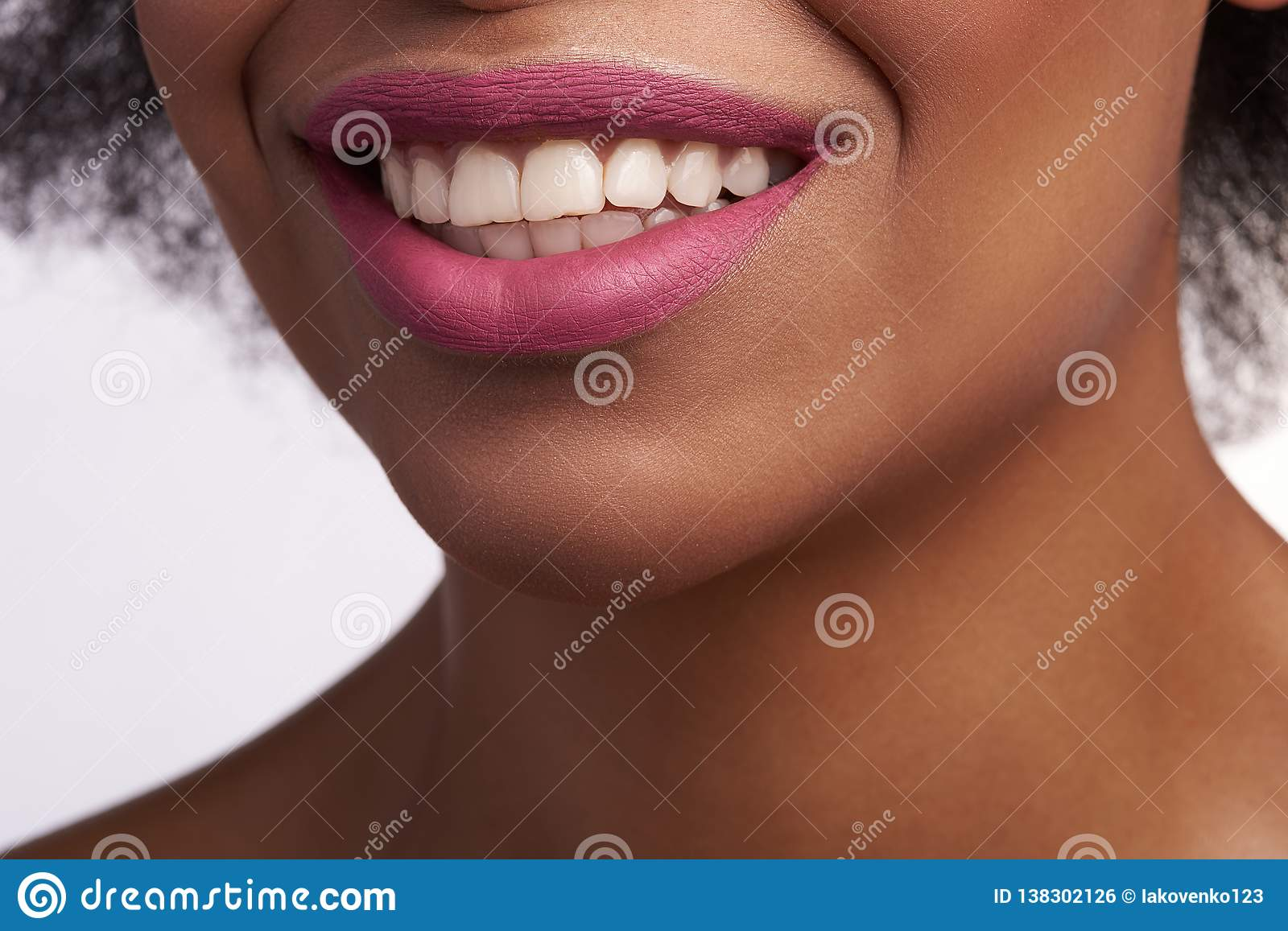 Close up of sensual smiling mouth of ethnic female