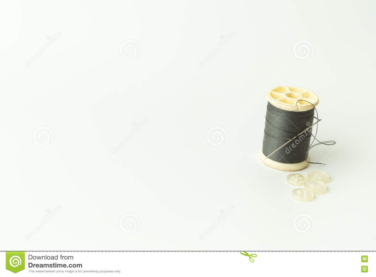 Close up of sewing items,Spool of thread, needle and button