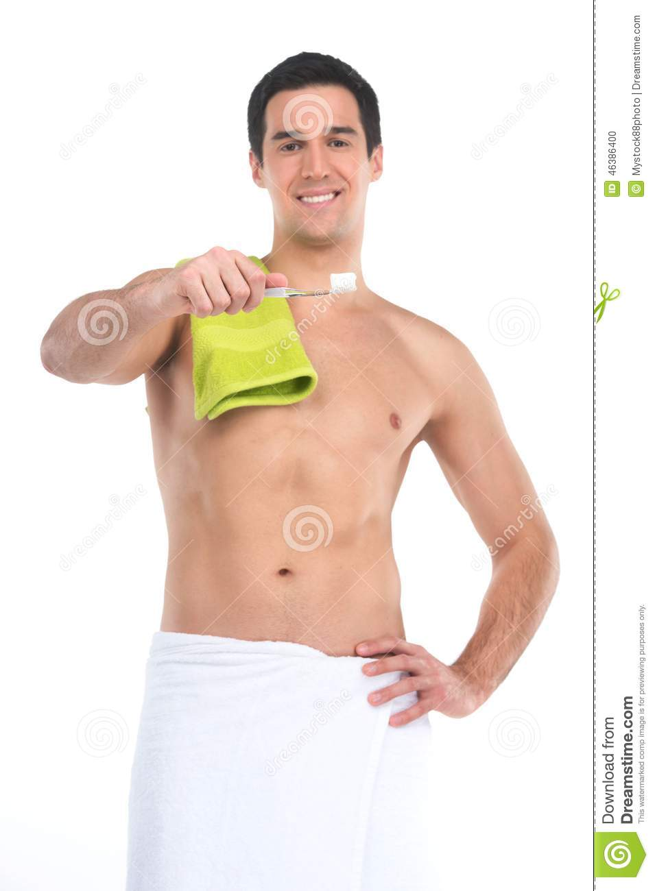 Close Up Of Sexy Fit Man In Towel Holding Toothbrush