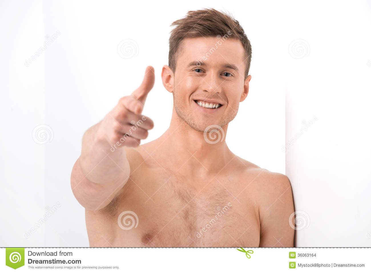 close up of handsome naked man smiling on camera. stock photo