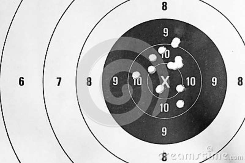 Black and white close up of a shooting target and bullseye with