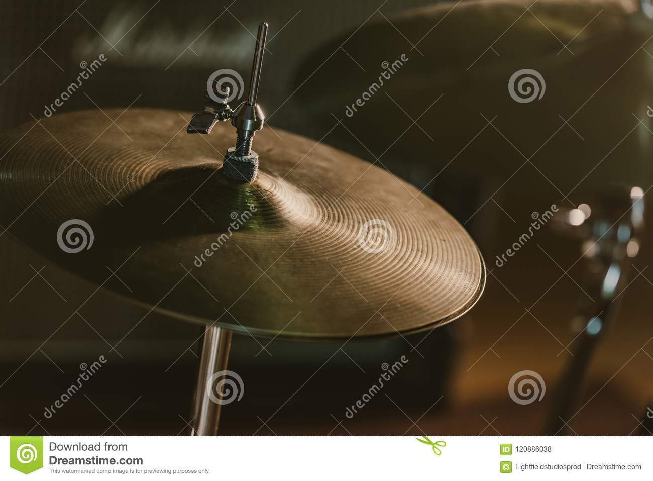 close-up shot of drum cymbal under spotlight