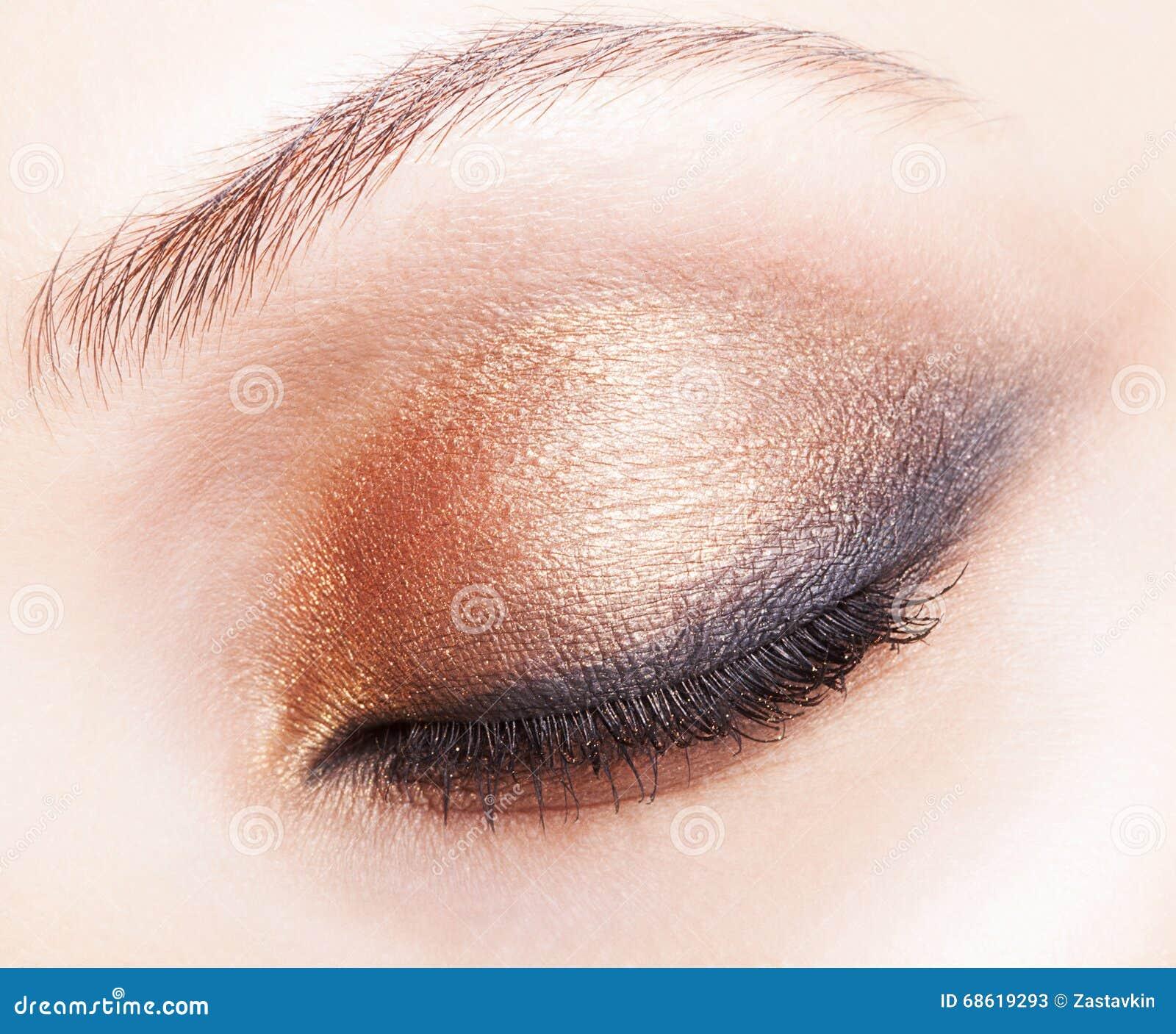 closeup shot of female closed eye makeup stock image