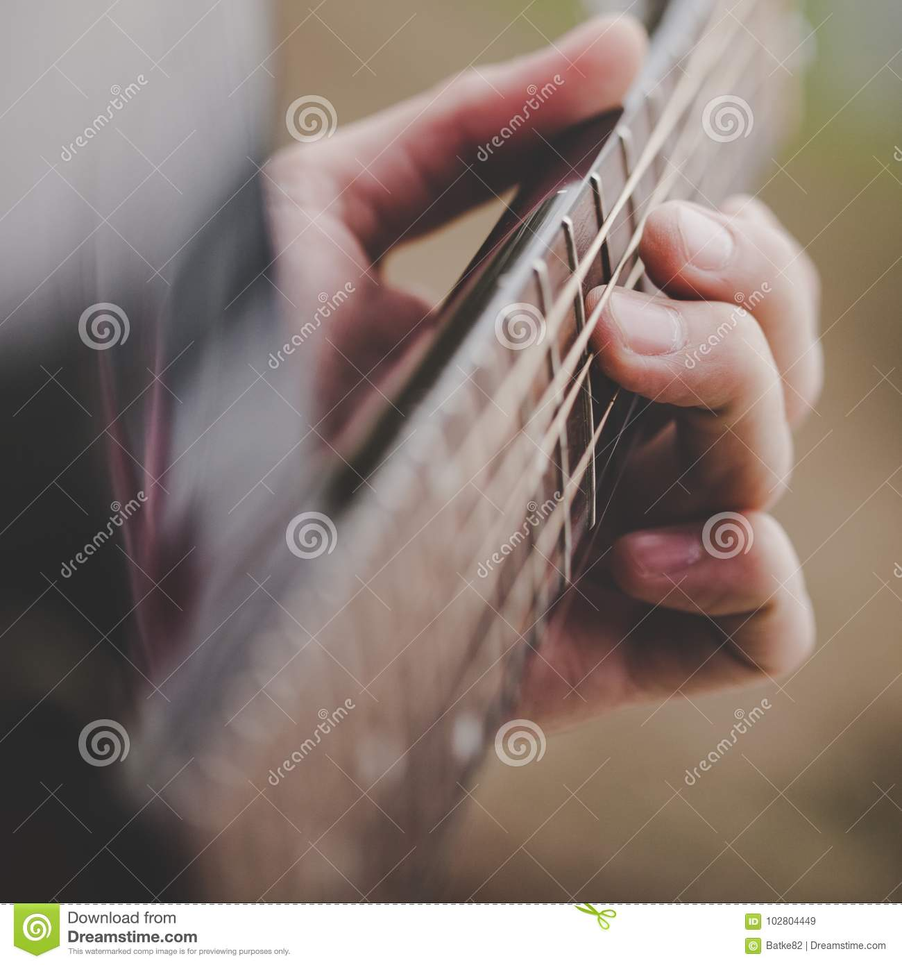 Hand Taking A Chord On Acoustic Guitar Close Up Stock Image