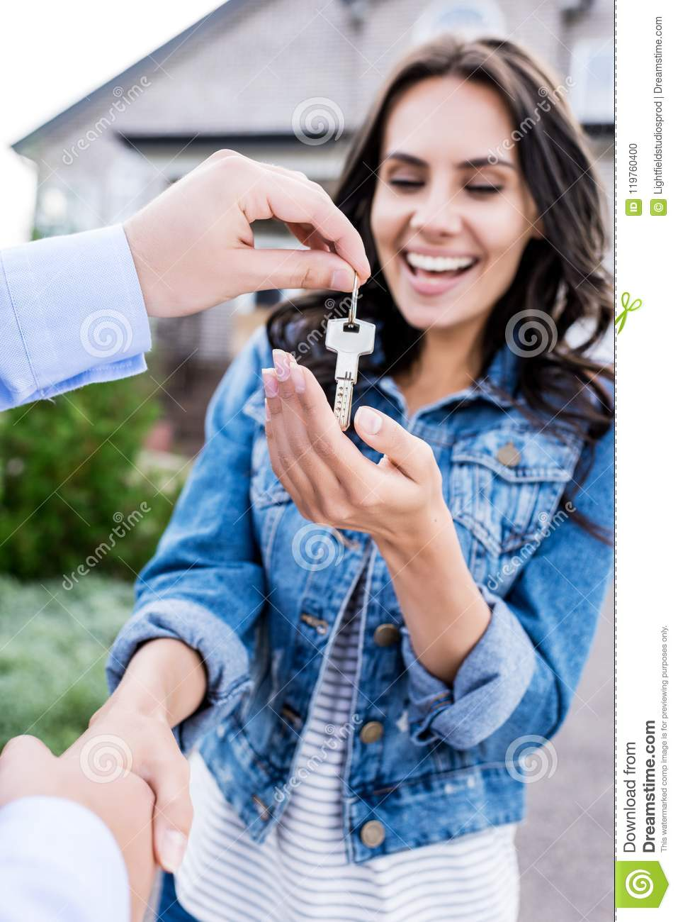 close-up shot of woman buying new house and shaking hands