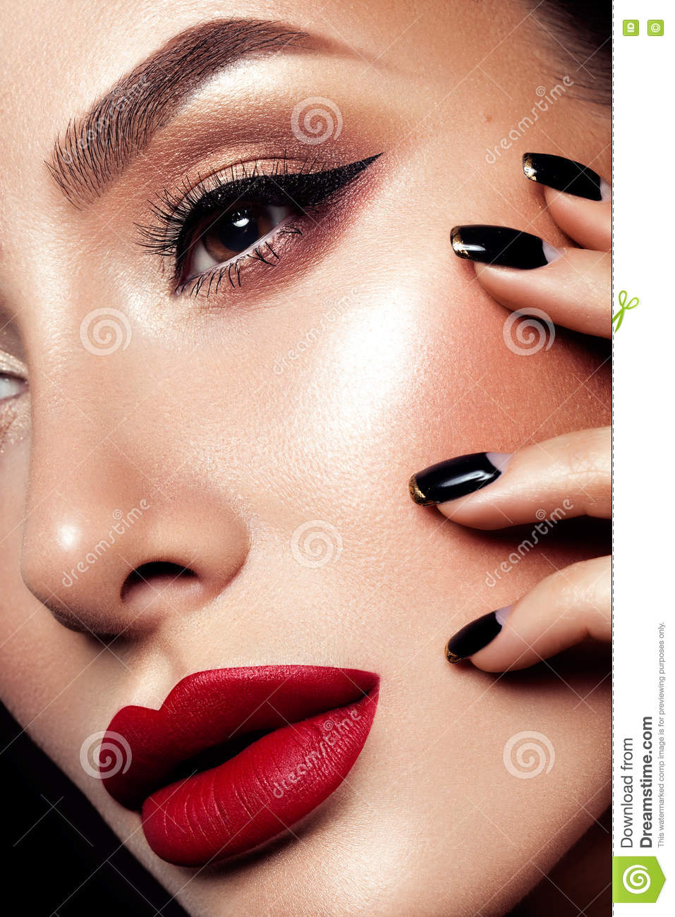 Close-up shot of woman lips with red lipstick.