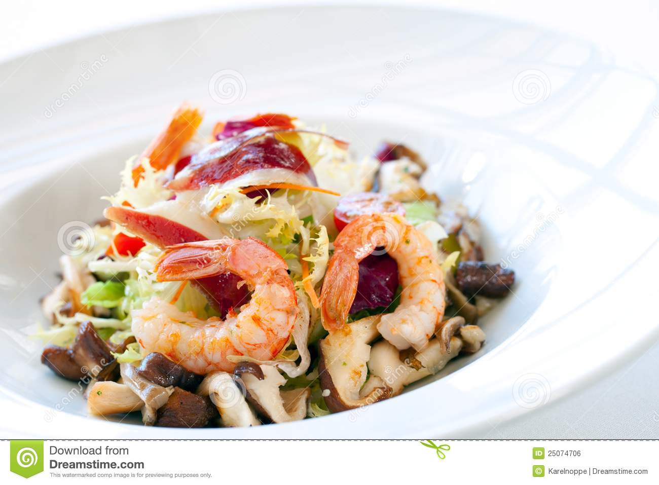 Close up shrimp salad with mushrooms and lettuce.