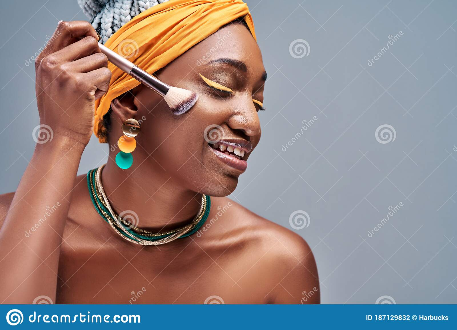 Close Up Side View Portrait Of Beautiful Aro American Woman Applying Makeup With Brush Stock Photo Image Of Blusher Cheerful 187129832
