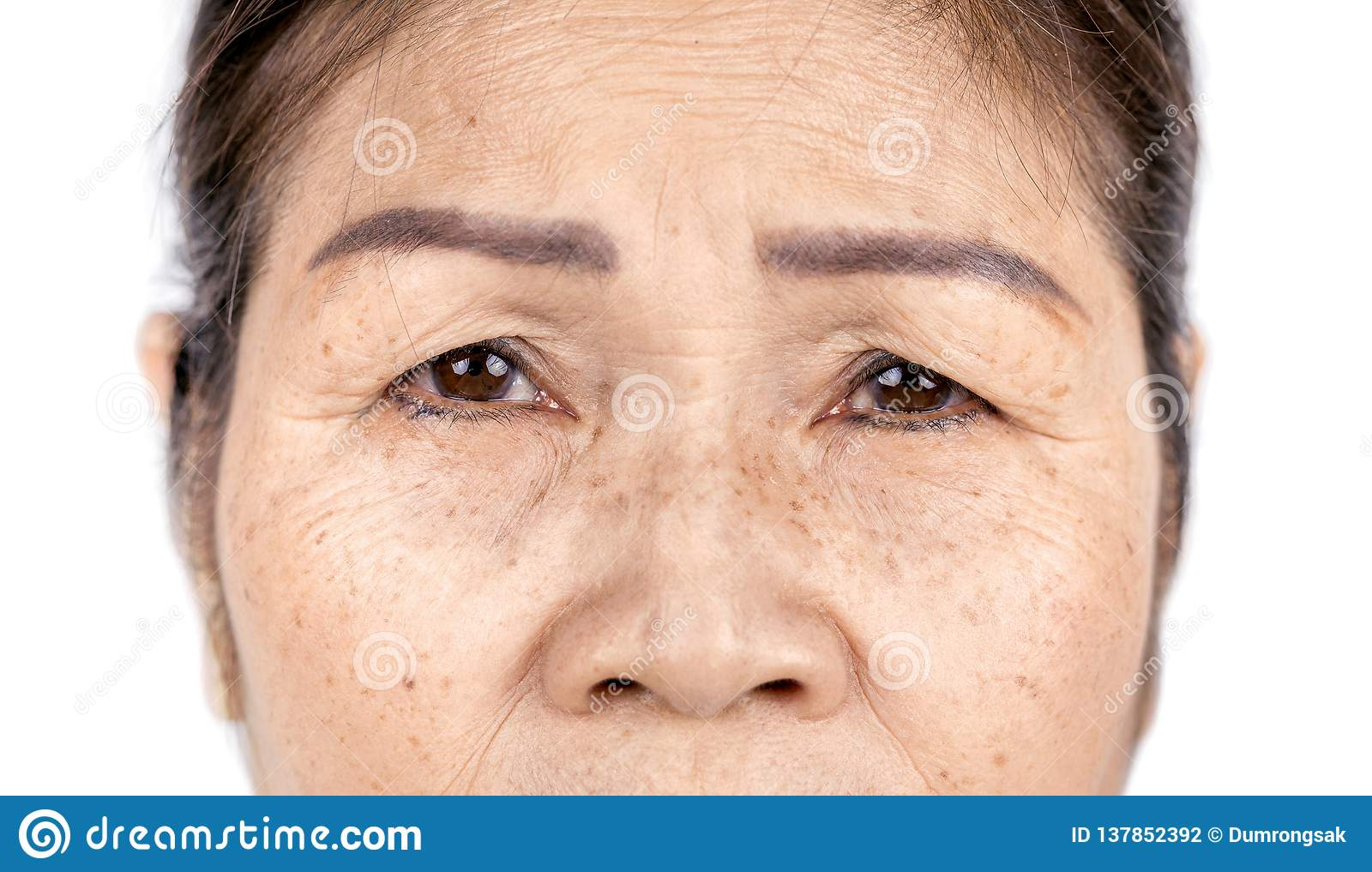 Close up skin wrinkle and freckles of old asian woman face