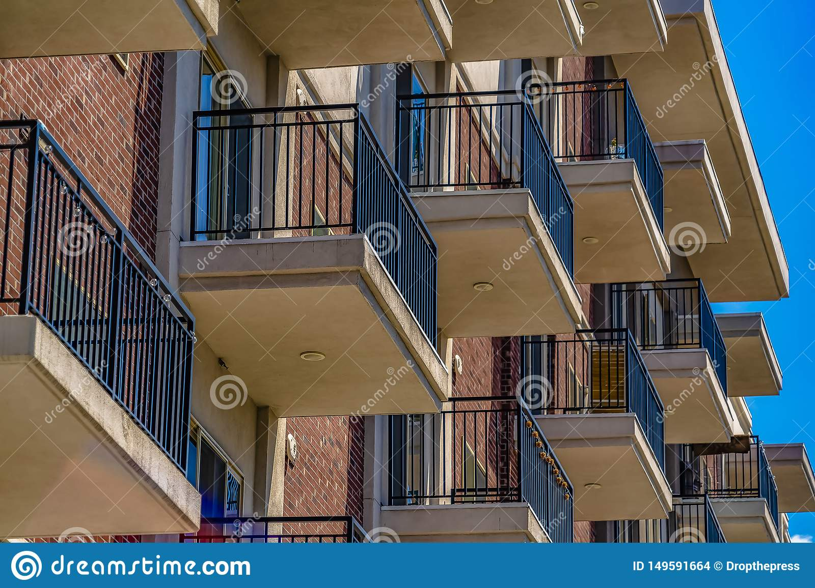Close up of the small balconies of a residential building on a sunny day