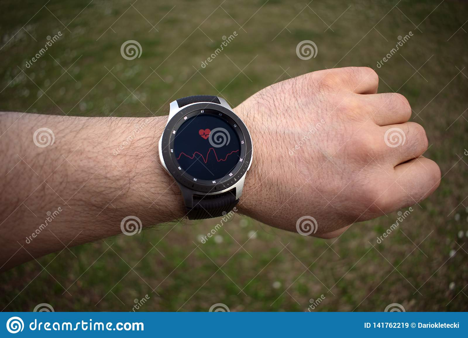 SSmartwatch on a man`s hand measuring heart rate