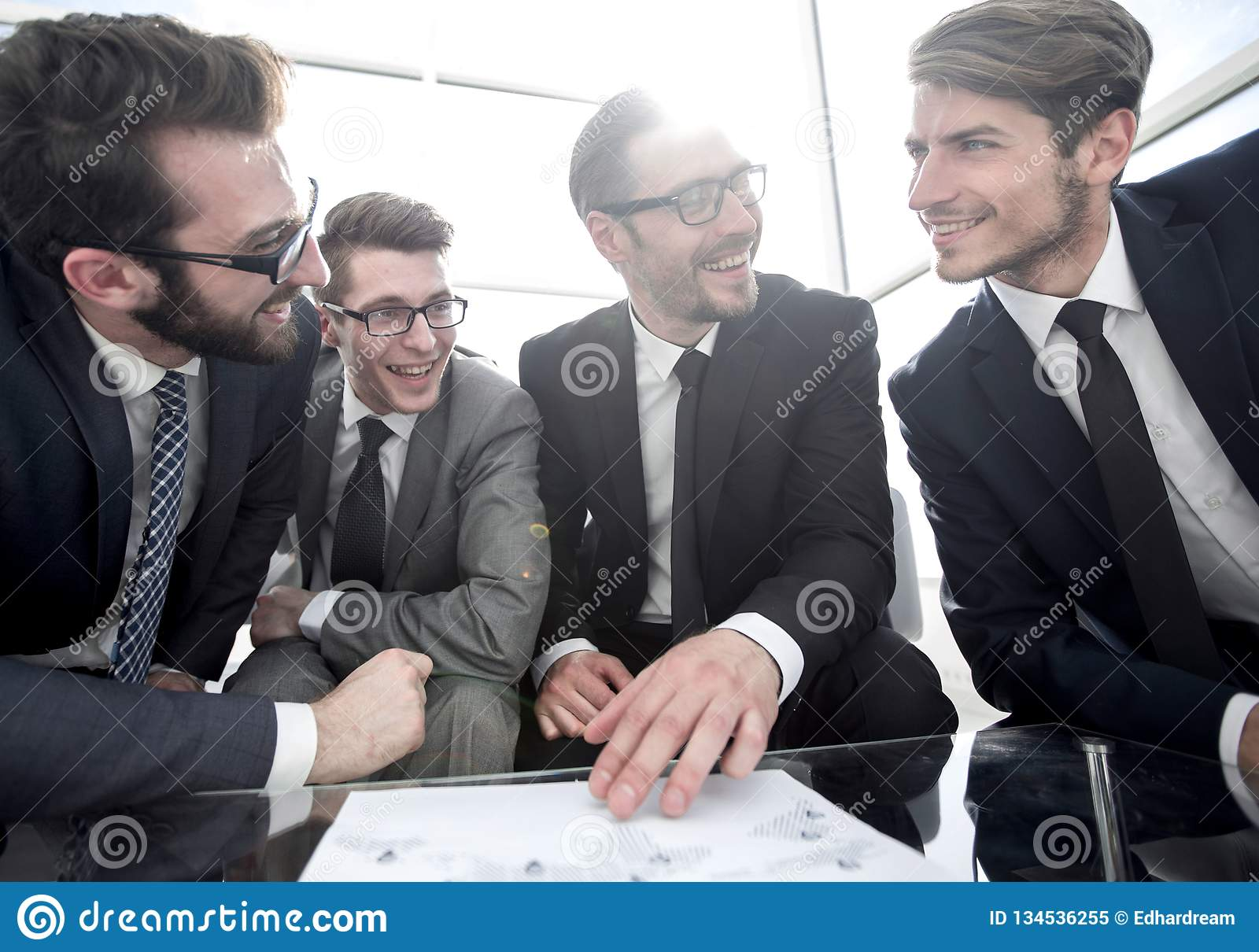 Close up.smiling business team discussing financial plan. Start-up royalty free stock photo