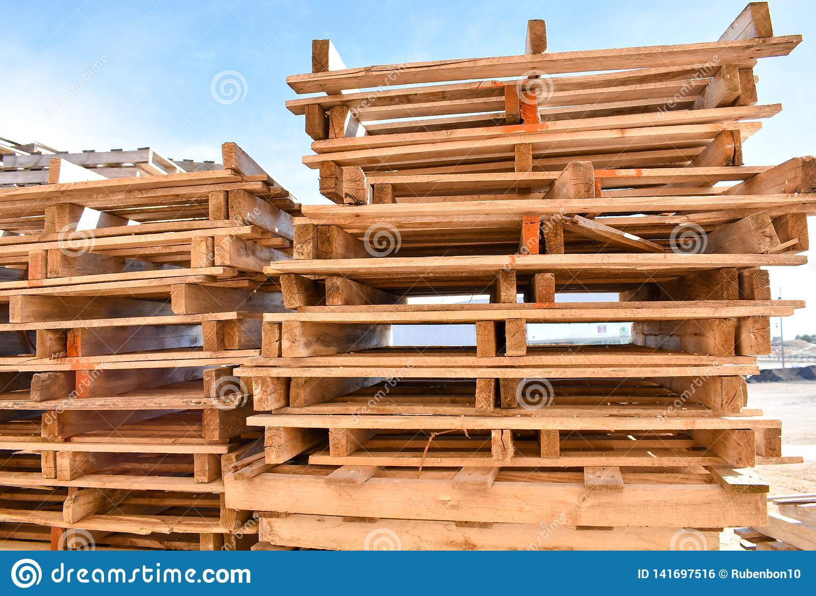 piles of european pallets made in wood ready to be used transporting products or goods on them from a place to other by truck,
