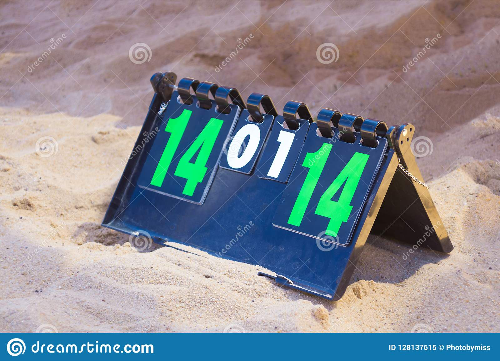 Close up of sport volleyball scoreboard on the summer sand. Score - tie, 14-14