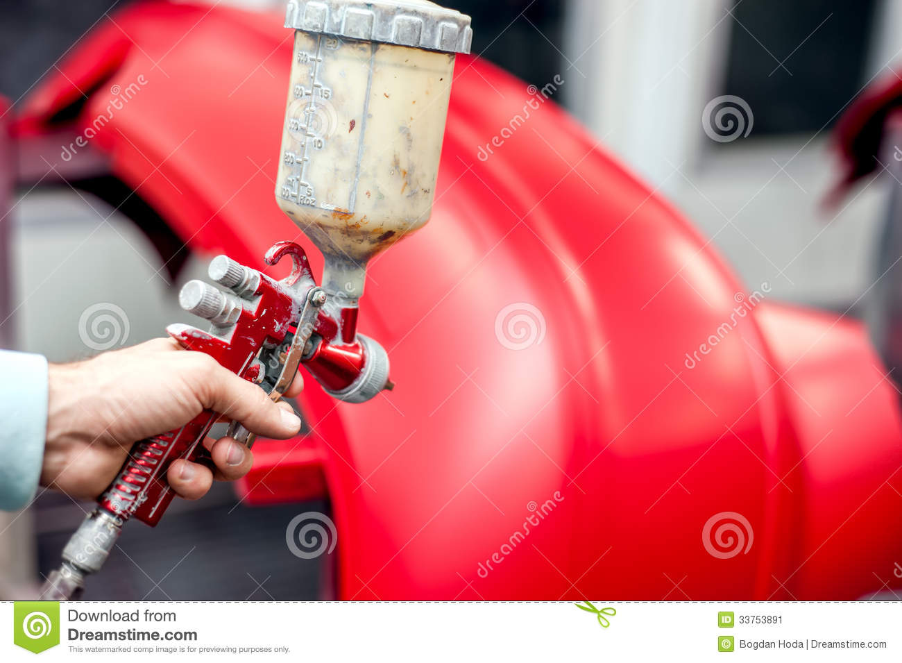close up of spray gun with red paint painting a car stock image. Black Bedroom Furniture Sets. Home Design Ideas