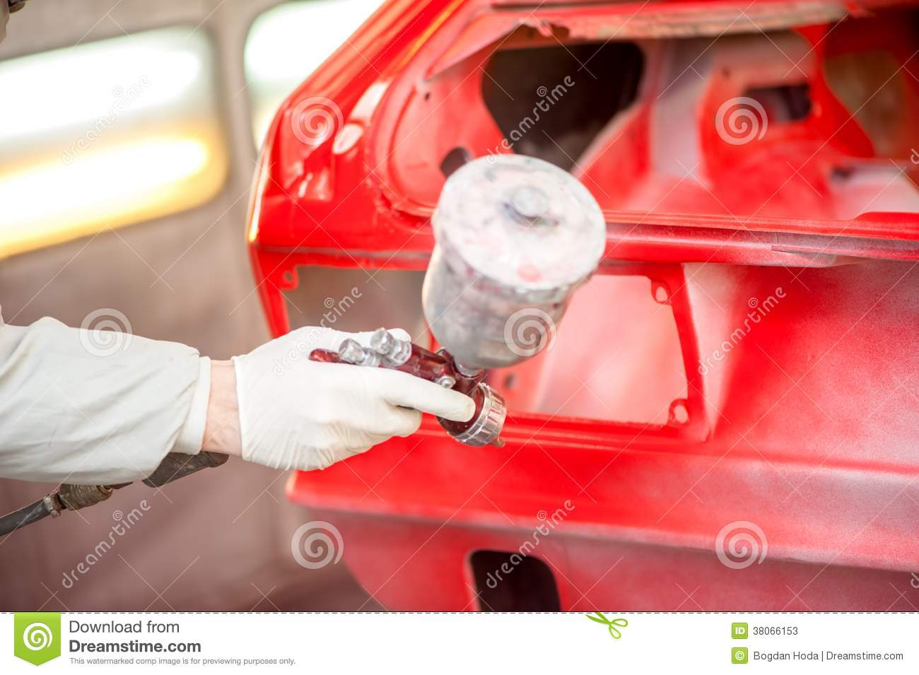 Close Up Of Spray Paint Gun Painting A Red Car Stock