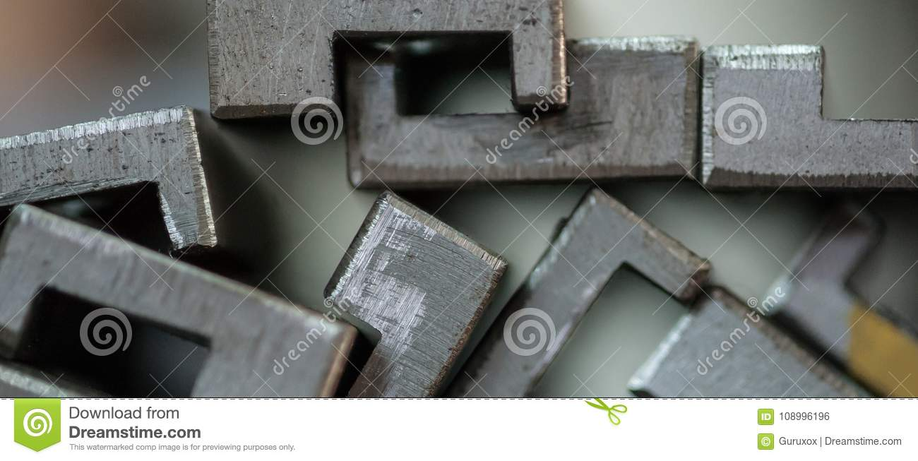 Close up of stacked metal plates