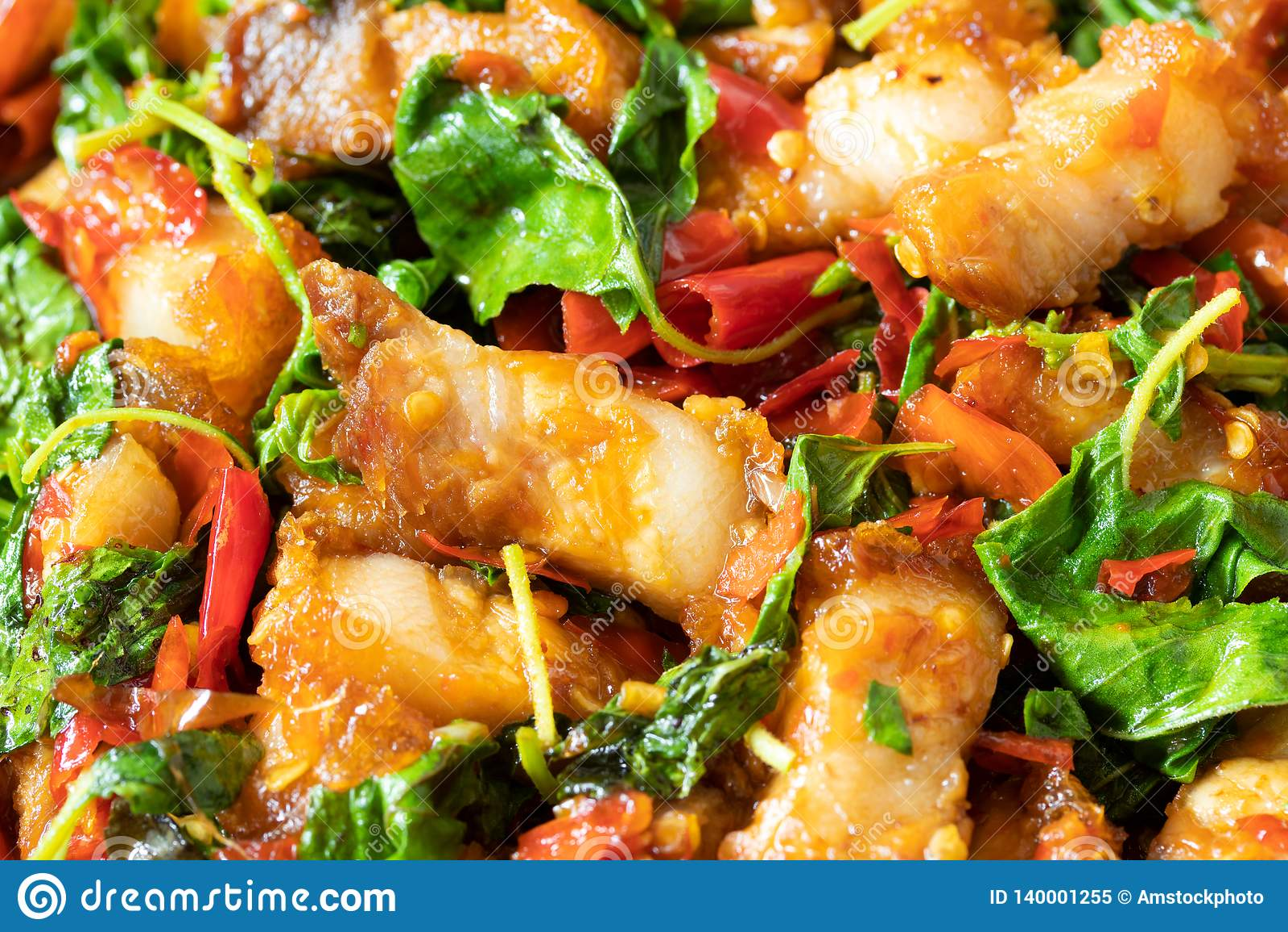Close up of stir fried crispy pork with holy basil, thai food