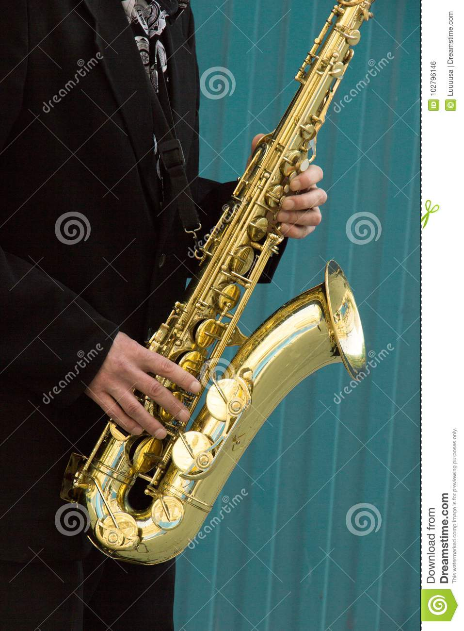 Close Up Of Street Saxophone Player Hands Playing Alto Sax