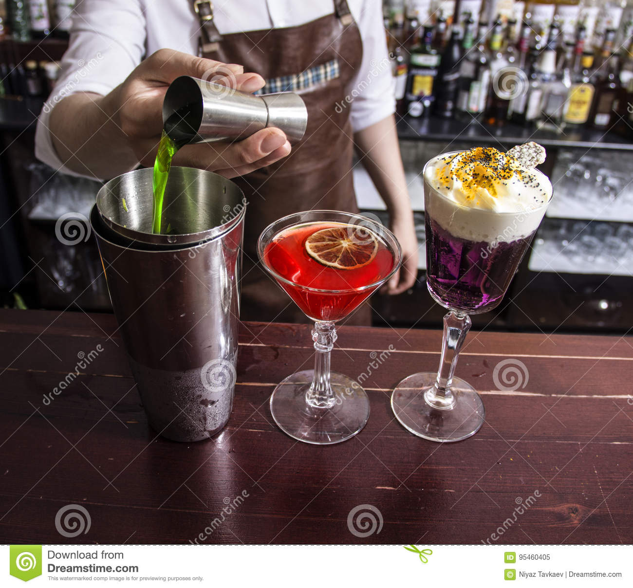 Close up of stylish barman making a cocktail