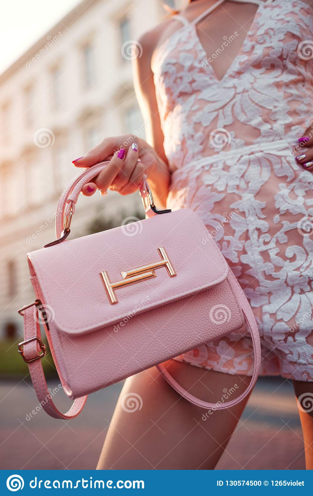 8e2fe382 Close-up of stylish female handbag. Fashionable woman holding beautiful  accessory and wearing outfit