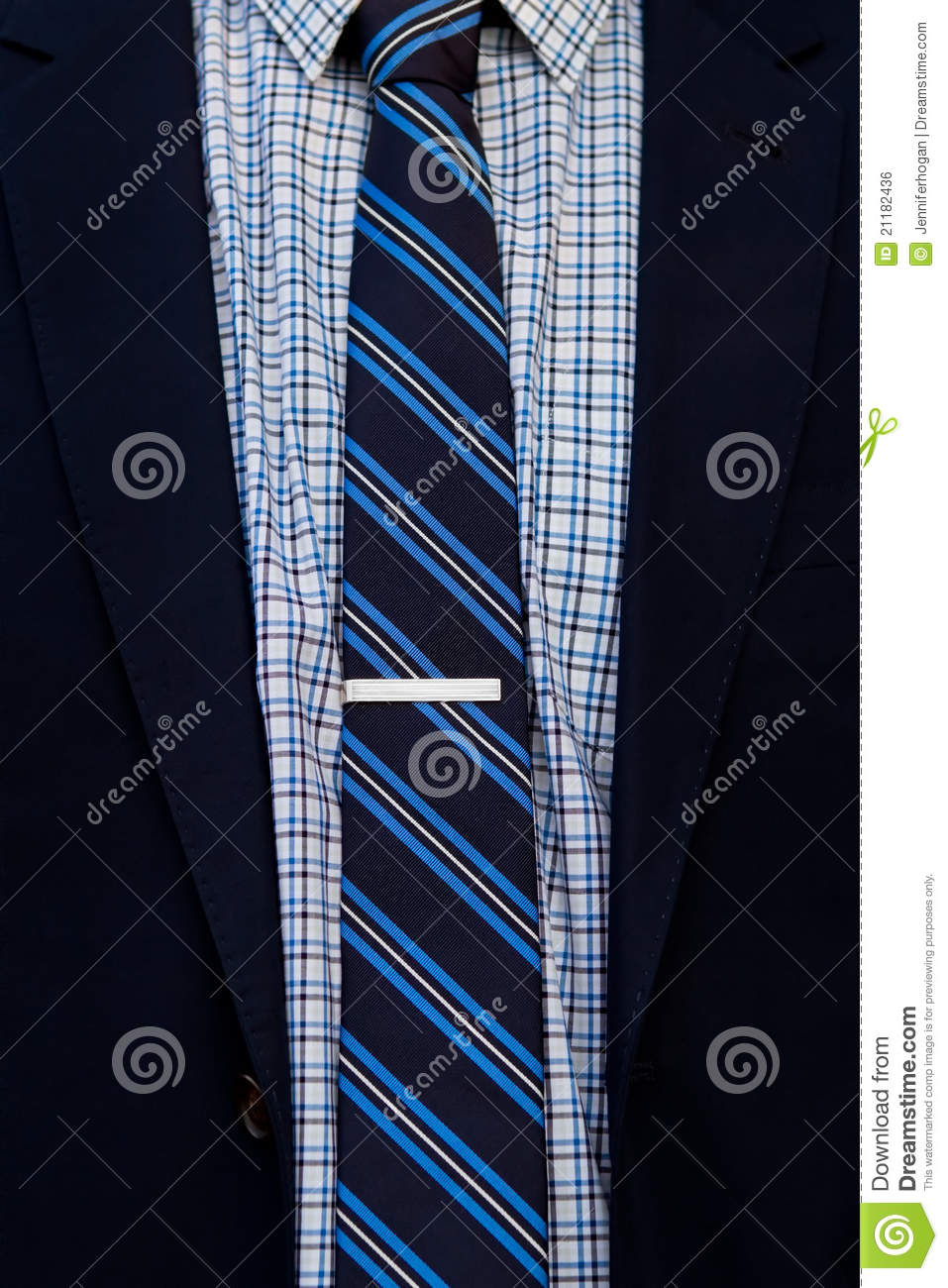 Close up of suit and tie with tie clip